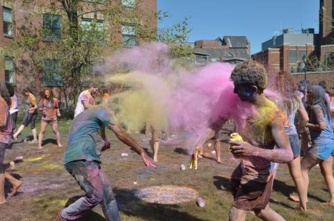 students flinging powder