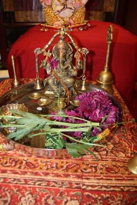 Ganesha murti with offerings after pooja