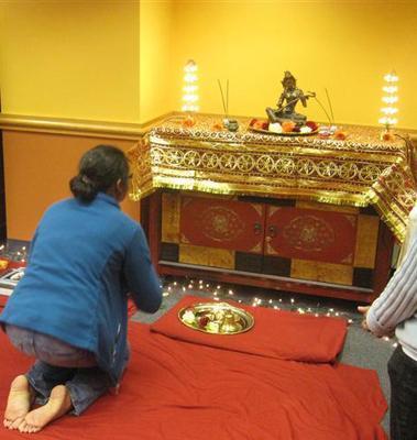 Student praying at altar
