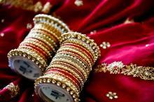 bangle sets placed on a sari