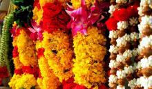 flower garlands hanging from a market stall